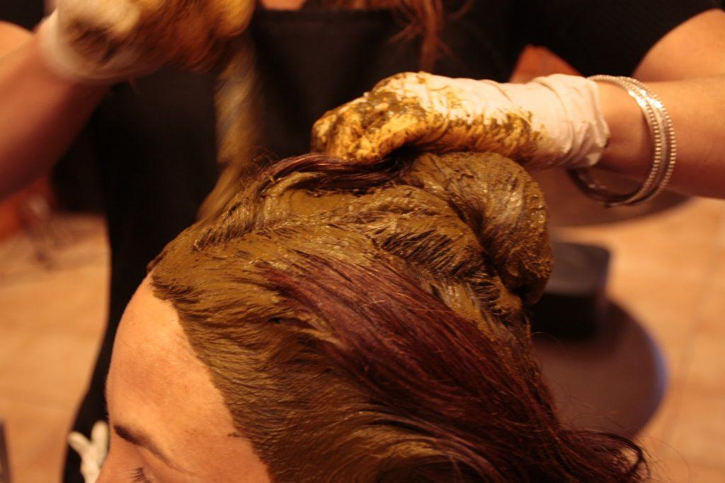 Applying Henna Dye Paste on Hairs